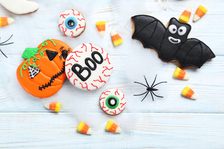 Fresh halloween gingerbread cookies on white wooden table