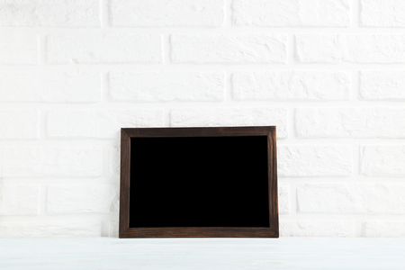 aged: Wooden frame on a brick wall background