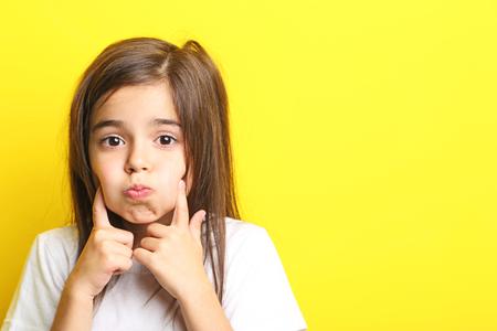 Beautiful little girl on yellow background Stock Photo