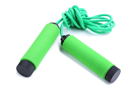 Green skipping rope isolated on a white background Stock Photo