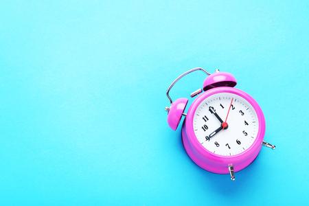 alarmclock: Pink alarm clock on the mint background
