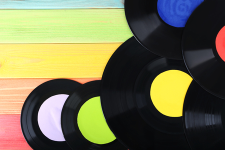 electronic music: Vinyl records on colourful wooden table Stock Photo