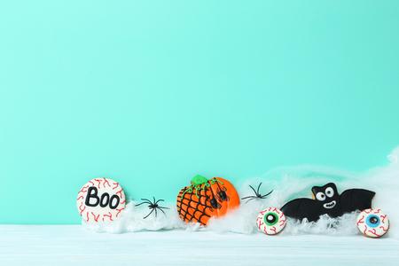 Fresh halloween gingerbread cookies on green background Stock Photo