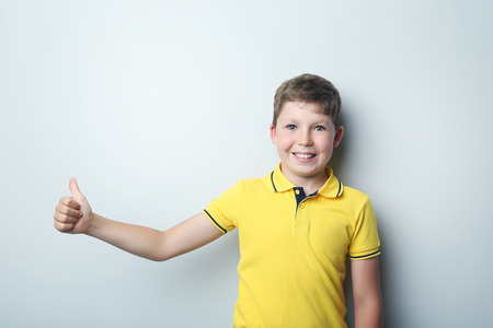 antics: Portrait of young boy on grey background