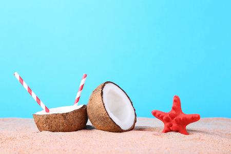 dcc65527ea3  83250217 - Half of coconut with starfish on beach sand