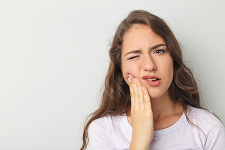Young woman have a toothache