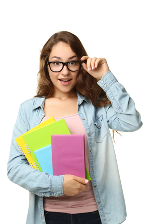 Portrait of student girl with books on white background Stock fotó