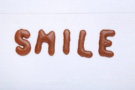 alphabetic character: Word Smile written by chocolate cookies alphabet Stock Photo