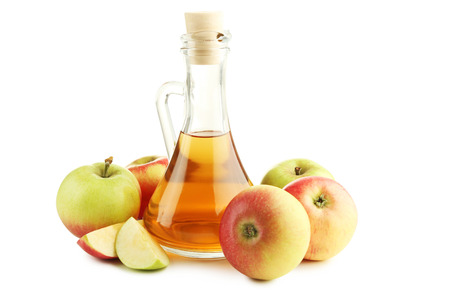 Apple vinegar in glass bottle isolated on white Stockfoto