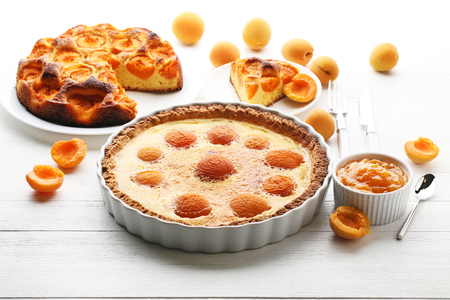Apricot pies with jam on white wooden table Stock Photo