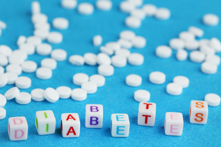 Sweetener tablets with inscription Diabetes on blue background