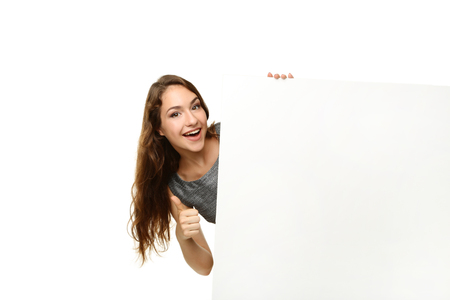 Young woman with blank paper on white background
