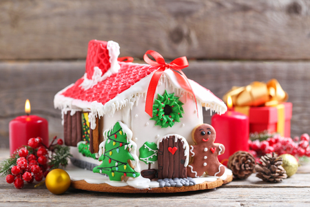 Christmas gingerbread house on grey wooden table