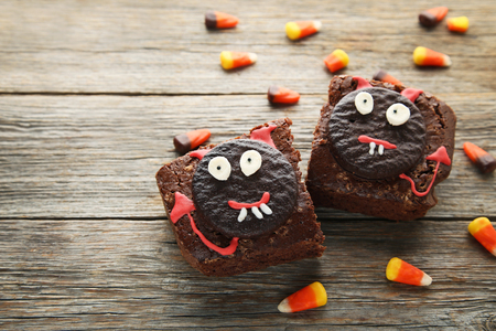 Fresh halloween cookies with candies on grey wooden table Stock Photo - 87866617