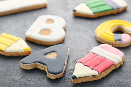 Gingerbread cookies on grey wooden table