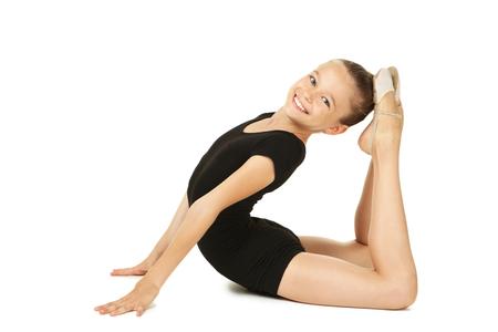 Turner des jungen Mädchens auf weißem Hintergrund Standard-Bild - 88440360