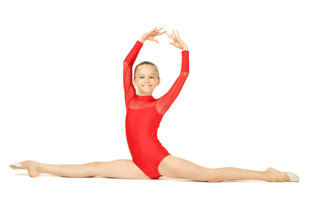 Young girl gymnast on white background
