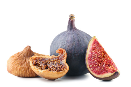 Ripe and dried figs on white background