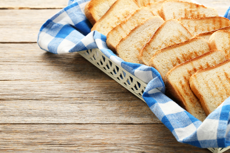 Toast bread with blue napkin in tray
