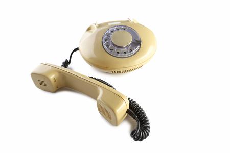 Beige retro telephone isolated on a white Stock Photo