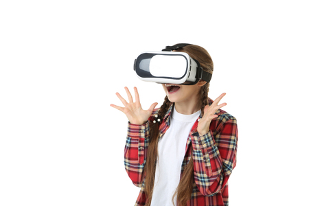 Young girl in virtual reality goggles on white background