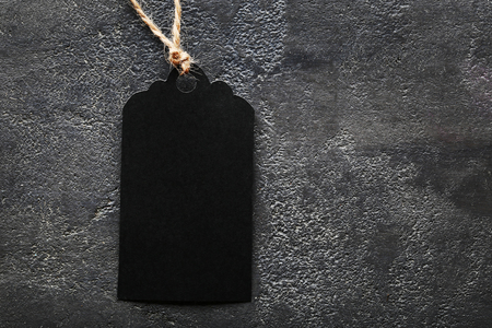 Black sale tag on grey background