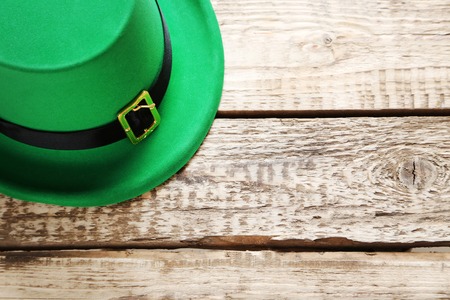 Green St. Patricks day hat on grey wooden table