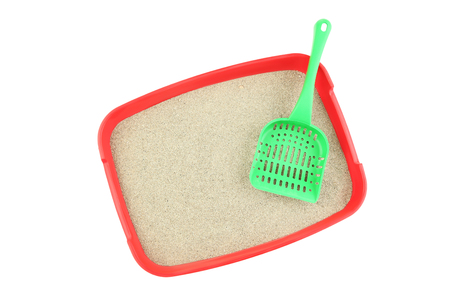 Red toilet tray with sand and scoop isolated on white