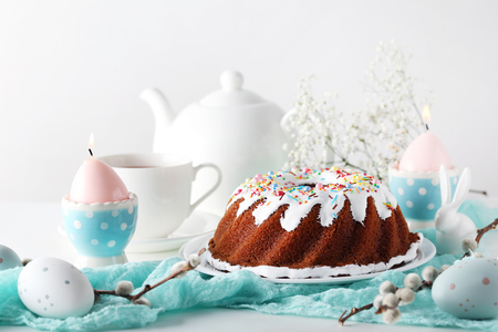 Bundt cake with sprinkles and easter eggs