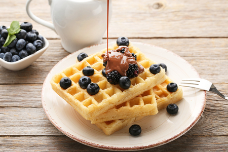 Sweet waffle with berries on grey wooden table 스톡 콘텐츠
