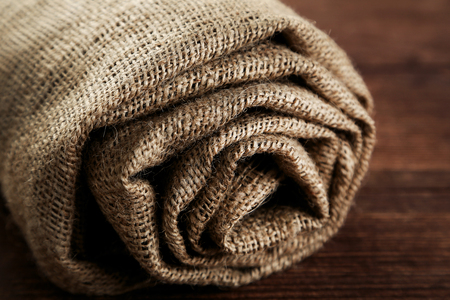Rolled up sackcloth on brown wooden table