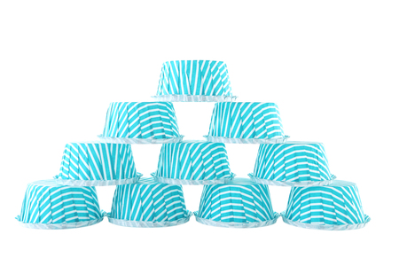 Empty cupcake cases isolated on white background