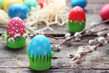 Colorful easter eggs on wooden table Stock Photo