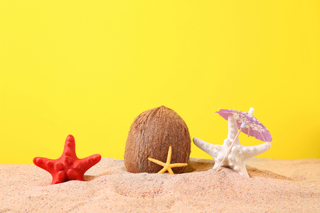 90ecf9cbad3  97392394 - Coconut with starfish on the beach sand