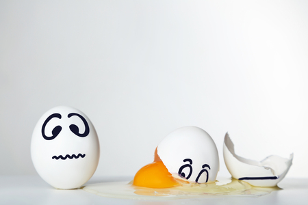 Eggs with funny faces on grey background Stock Photo