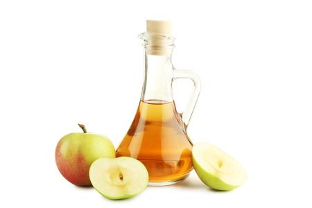 Apple vinegar in glass bottle isolated on white Foto de archivo