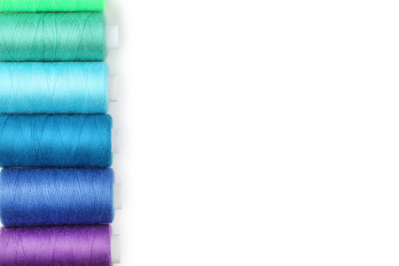 Colourful thread spools on white background 写真素材