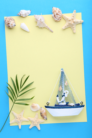 Blank sheet of paper with seashells and decorative ship on blue background Reklamní fotografie