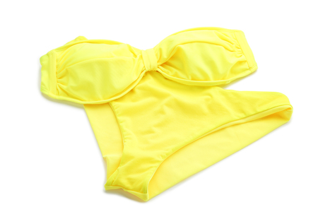 Yellow swimsuit isolated on a white background