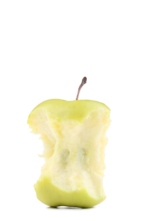 Green apple stub isolated on white background Фото со стока