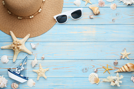 9674ed716d0 Different seashells with sunglasses and decorative ship on wooden table  Stock Photo
