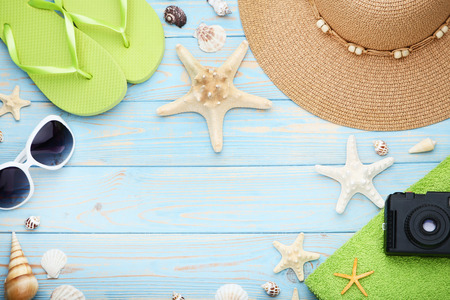 d2c56835d66 Summer accessories with seashells on wooden table Stock Photo