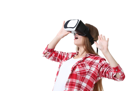 Young woman in virtual reality goggles on white background