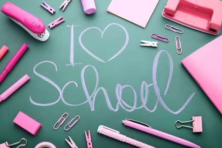 Inscription I Love School on chalkboard with school supplies Stock Photo