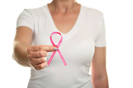 Female hand holding pink ribbon, medicine concept