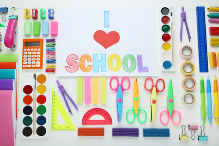 Inscription I Love School with school supplies on wooden table Stock Photo