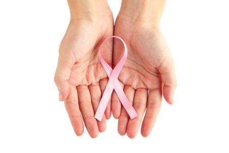 Female hands holding pink ribbon, medicine concept Stockfoto