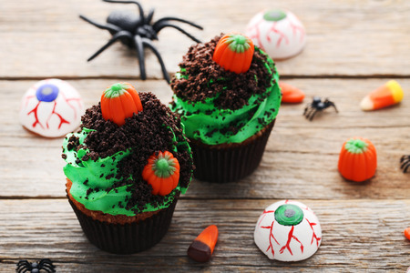 Halloween cupcakes on grey wooden table