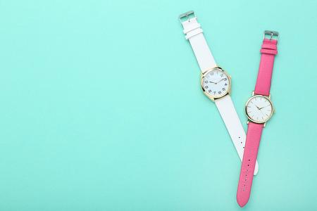 Wrist watches on mint background Stock Photo
