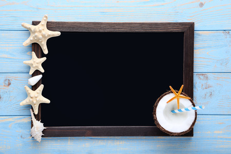 Seashells and starfishes with black wooden frame